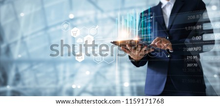 Businessman using tablet analyzing sales data and economic growth graph chart.  Business strategy. Abstract icon. Digital marketing. #1159171768