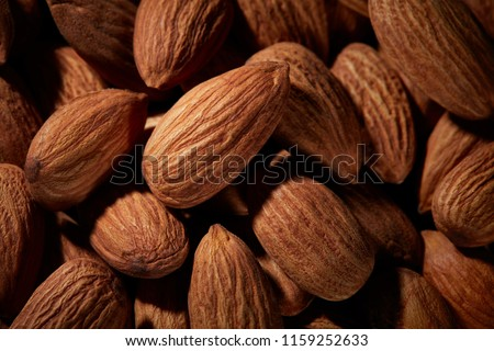 Organic texture of almonds. View from above. Almond. Almonds macro. Almonds background. Almond nuts. #1159252633