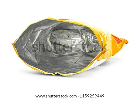 Potato chips bag isolated on white background. Inside of leftovers snack packaging. Royalty-Free Stock Photo #1159259449