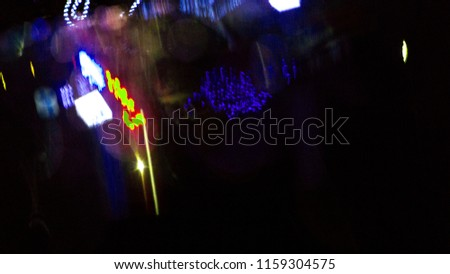 Night abstract bokeh background, bright glare of neon light on a wet, glossy surface. Blurred background. #1159304575