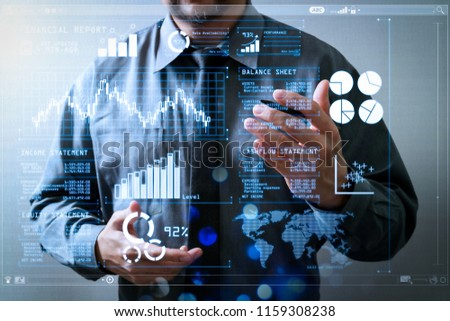 Investor analyzing stock market report and financial dashboard with business intelligence (BI), with key performance indicators (KPI).success businessman open his hand,working touch screen computer #1159308238