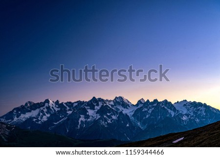 Scenic view of beautiful Swiss Alps mountains. Blue hour sunset with pink and blue tones, Verbier, Canton du Valais, Wallis, Switzerland.