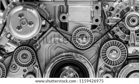 View on pulley and belts on a car engine. Royalty-Free Stock Photo #1159426975