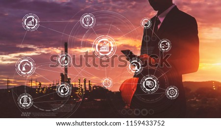 Businessman in safety helmet touching virtual interface screen as concept of industry 4.0  #1159433752