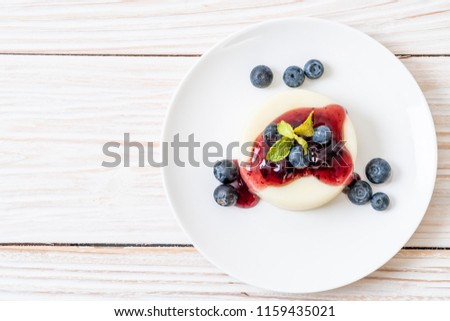 yogurt pudding with fresh blueberries - healthy food and dessert #1159435021