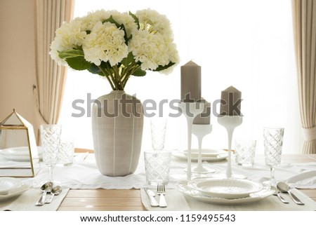 Beautiful table dinning set decorated for various festive event. #1159495543