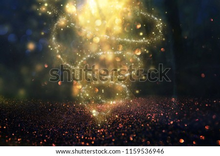 Abstract and magical image of glitter Firefly flying in the night forest. Fairy tale concept