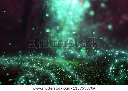 Abstract and magical image of glitter Firefly flying in the night forest. Fairy tale concept #1159538704