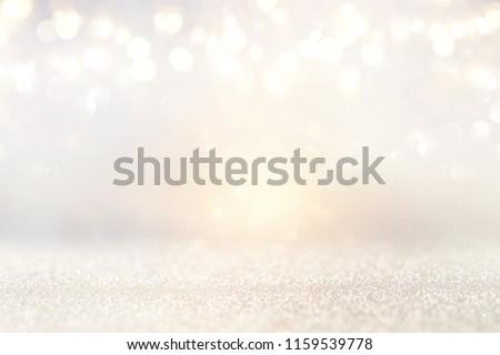 glitter vintage lights background. silver and light gold. de-focused #1159539778