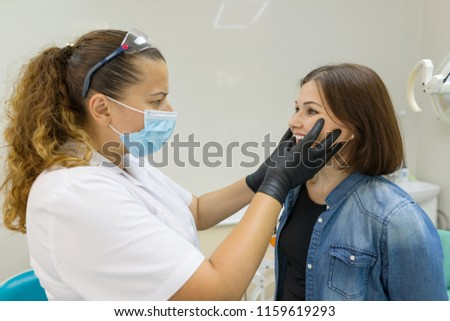 Adult woman suffering from toothache and complaining during visit to professional dentist #1159619293