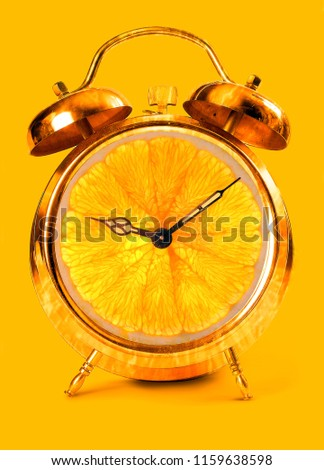 Creative idea fresh portion outdoor alarm clock on yellow background. Business concept minimal idea. creative fruit idea to advertise work within an advertising marketing communication #1159638598