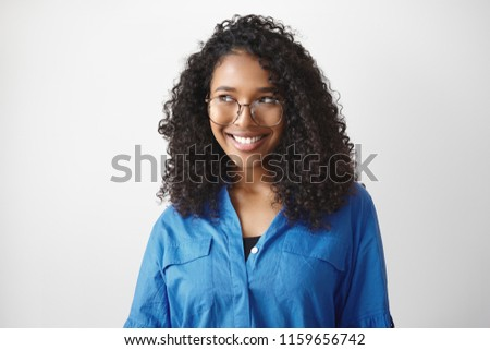 Peolple, style, fashion, eyewear, optics and vision concept. Cute beautiful young African American woman with curly hair smiling broadly, feeling happy because she able to see clearly using eyeglasses #1159656742