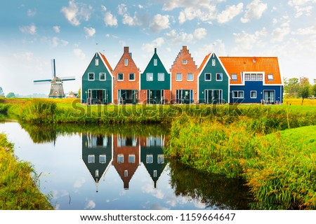 Volendam is a town in North Holland in the Netherlands. Colored houses of marine park in Volendam. North Holland, Netherlands. #1159664647