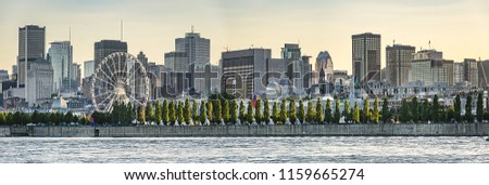 Gorgeous skyline of Montreal as seen across the St. Lawrence River at sunset. Montreal, Quebec, Canada.