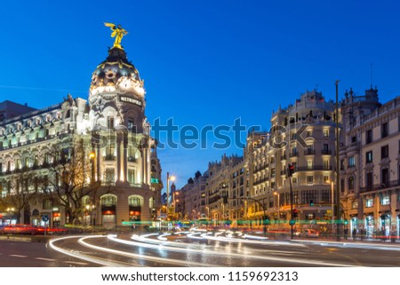 MADRID, SPAIN - JANUARY 23, 2018:  Sunset view of Gran Via and Metropolis Building (Edificio Metropolis) in City of Madrid, Spain #1159692313