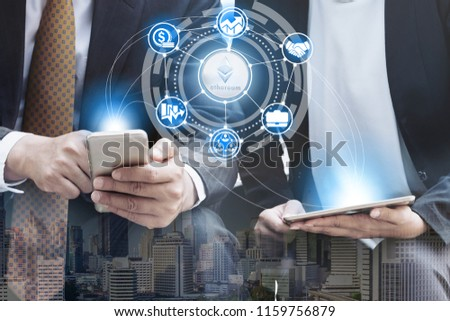 Ethereum and cryptocurrency investing concept - Businessman using mobile phone application to trade Ethereum ETH with another trader in modern graphic interface. Blockchain and financial technology. #1159756879