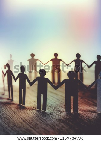 unity of paper human symbol with colorful background Royalty-Free Stock Photo #1159784998