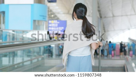 Woman go for a trip in the airport #1159807348