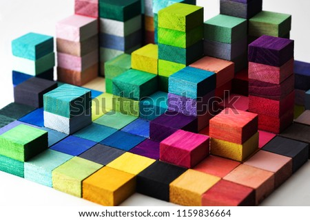 Spectrum of stacked multi-colored wooden blocks. Background or cover for something creative, diverse, expanding,  rising or growing.  Royalty-Free Stock Photo #1159836664