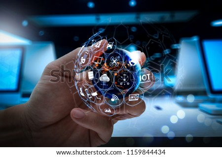 Internet of Things (IOT) technology with AR (Augmented Reality) on VR dashboard.businessman showing world globe.Elements of this image furnished by NASA #1159844434