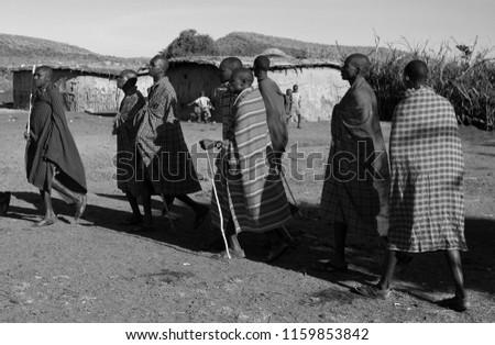 Unidentified Maasai men on Oct 15, 2012 in the Maasai Mara, Kenya. Maasai are a Nilotic ethnic group of semi-nomadic people located in Kenya and northern Tanzania. #1159853842