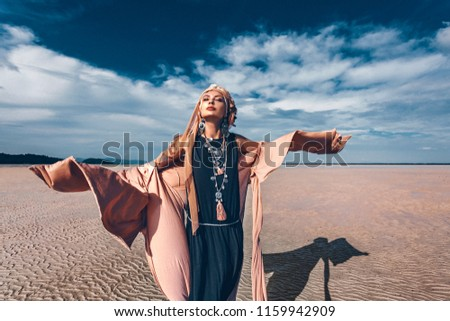young stylish woman with fashionable boho accessories on the beach windy time #1159942909