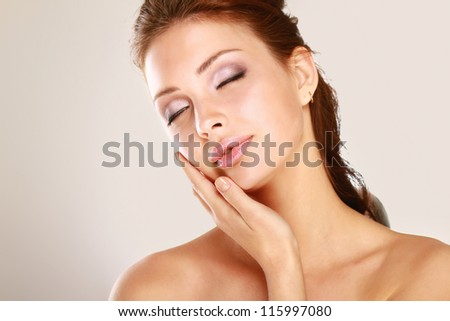 Happy woman touching her face isolated on white background #115997080