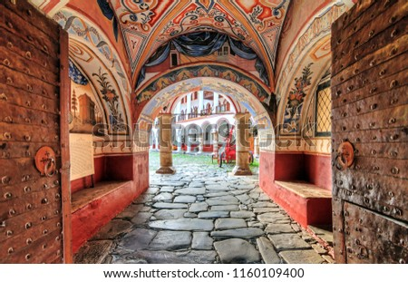 Beautiful view of the entrance gate at the Orthodox Rila Monastery, a famous tourist attraction and cultural heritage monument in the Rila Nature Park mountains in Bulgaria #1160109400