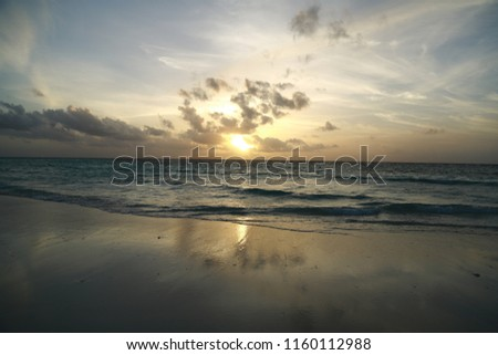 Maldivian beautiful and colourful sunset on the beach with sea view