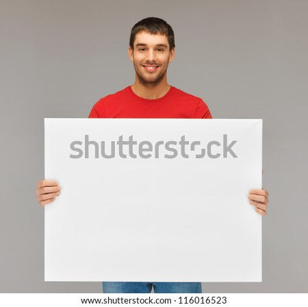 bright picture of handsome man with big blank board. #116016523