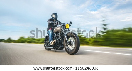 custom motorbike on the road riding. having fun driving the empty road on a motorcycle tour journey. copyspace for your individual text. #1160246008