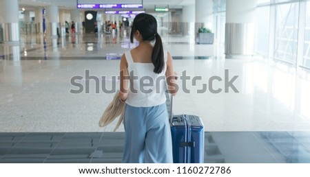 Woman walking in the airport, prepare for check in #1160272786