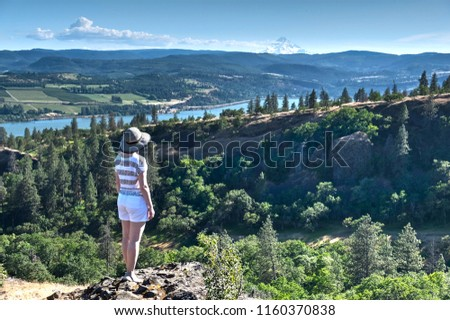 Woman in vacation in Oregon enjoying view of Mount Hood. Columbia River Gorge. Catherine creek. Columbia River Gorge. The Dalles. Oregon. United States of America. #1160370838