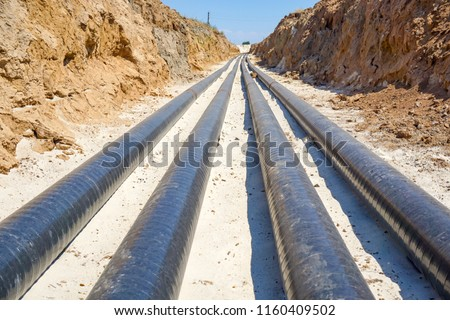 Technological pipelines DN50 and DN 150 make a turn by means of bends in the trench and approach the well #1160409502