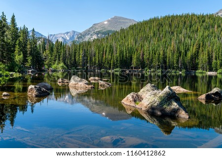 Bear Lake - A sunny summer morning view of a rocky section of Bear Lake, Rocky Mountain National Park, Colorado, USA. Royalty-Free Stock Photo #1160412862