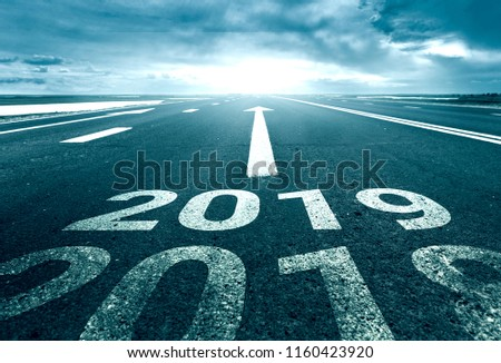 A desert road with the inscription 2018 2019. Concept of the departing old year and new goals. Royalty-Free Stock Photo #1160423920