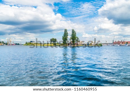 Landscape view on the Odra River in Szczecin, Poland. Royalty-Free Stock Photo #1160460955