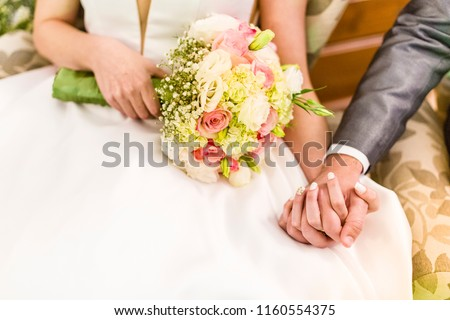Groom holding bride's hand during wedding party #1160554375