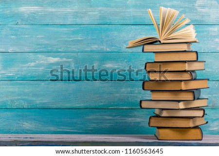 Open book, hardback books on wooden table. Back to school. Copy space Royalty-Free Stock Photo #1160563645