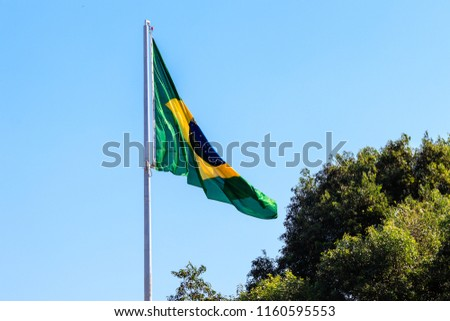 brazilian flag in the wind #1160595553