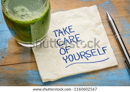 take care of yourself - inspirational handwriting on a napkin with a glass of green juice #1160602567