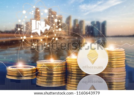 Ethereum ETH and cryptocurrency investing concept - Physical Ethereum coins with city background and exchange market trading price chart. Blockchain and financial technology. #1160643979
