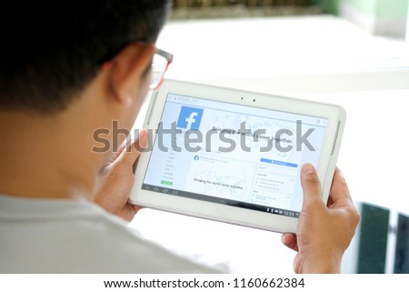 August 5, 2018 Bangkok, Thailand young men use computer laptop internet  looking screen Facebook is social networking service.he surf the Internet to get information of the world. #1160662384