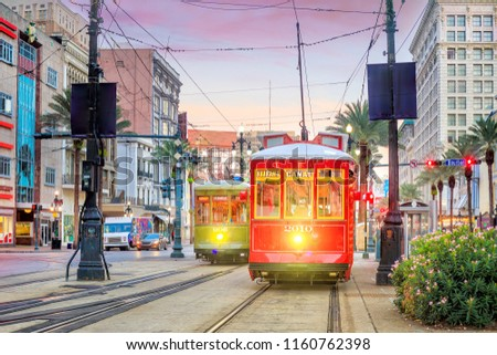 Streetcar in downtown New Orleans, USA at twilight Royalty-Free Stock Photo #1160762398