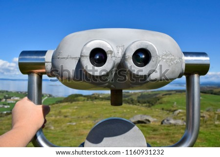 Panoramic binoculars on top of a hill. Tourist places. Travel around Norway. View of the sea. Blue sky. Sunny day. #1160931232
