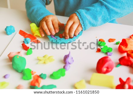 Child playing with clay molding shapes #1161021850