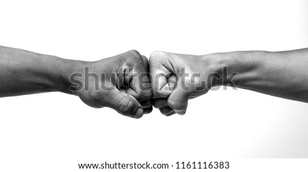 Man giving fist bump, monochrome, black and white image.  #1161116383