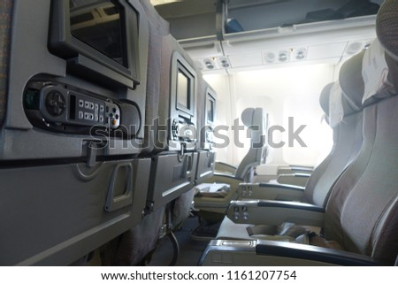 The interior of an empty aircraft, ready to fly cabin airliner with rows of seats. #1161207754