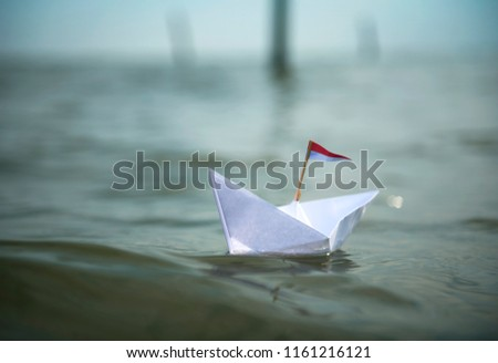 Paper Boat by the Sea #1161216121