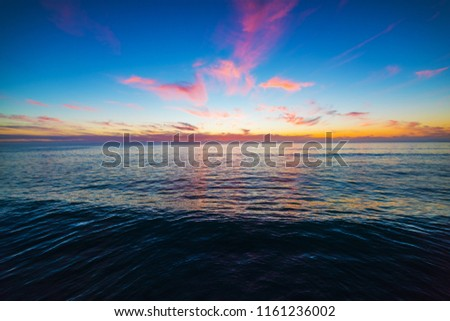 Colorful sky over Pacific Beach coastline at sunset. San Diego, Southern California #1161236002